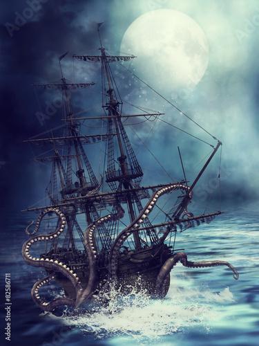 Naklejka premium Statek wciągany pod wodę przez macki