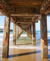 FototapetaOld cement broken pier at the sea.