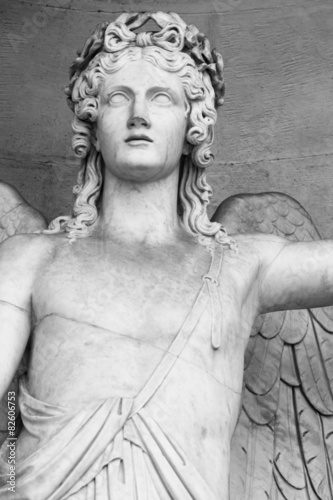 Poster Inspiration painterly detail of a marble statue depicting an angel with wings