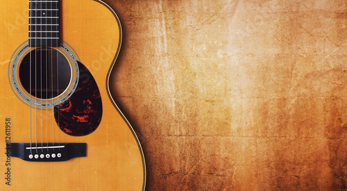 Guitar and blank grunge background