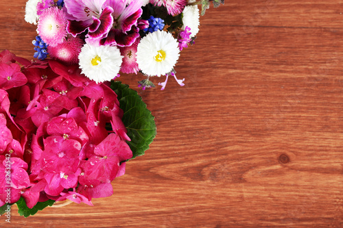 Top view of colorful spring flowers on wooden background buy this top view of colorful spring flowers on wooden background mightylinksfo