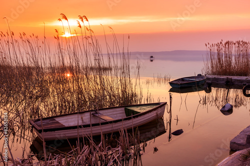 Fotografering  Sunset on the lake Balaton with a boat