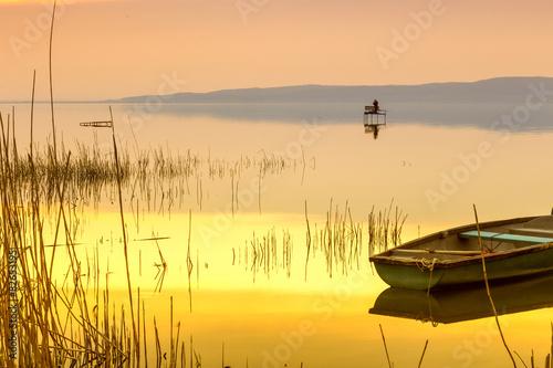Canvas Print Sunset on the lake Balaton with a boat