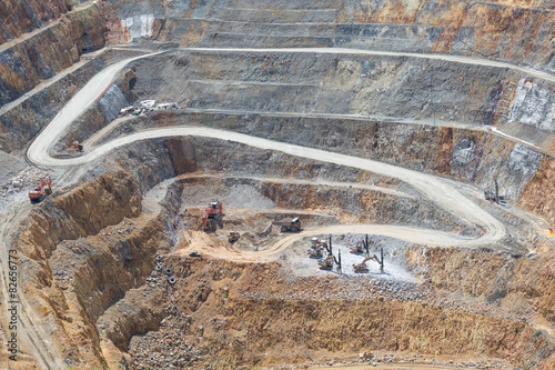 Fotografia, Obraz  Bottom of open pit and machinery of a gold mine martha in Waihi,