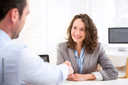 Obraz Young attractive woman during job interview - fototapety do salonu