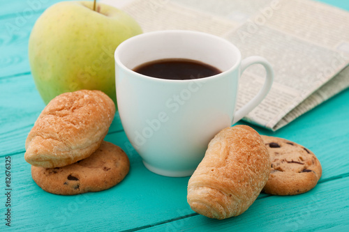 Fotografie, Tablou  Morning coffee with sweets and apple on blue wooden table