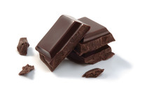 Chocolate Pieces Isolated On A White Background.