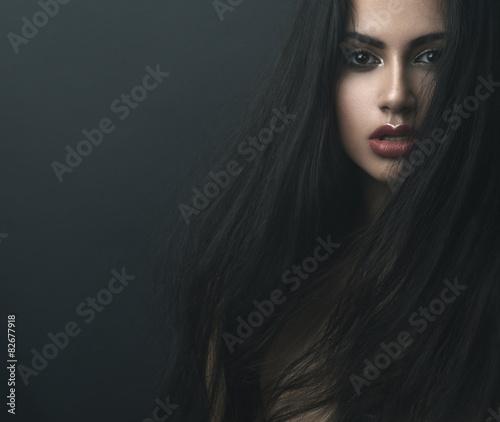 Fototapeta mysterious portrait of a girl in  dark  fog obraz