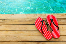 Flip Flops On Wooden Deck Over Water Background