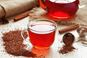 Healthy traditional herbal rooibos beverage tea with spices on