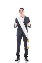 Young Elegant Man Wearing Winning Ribbon Or Sash