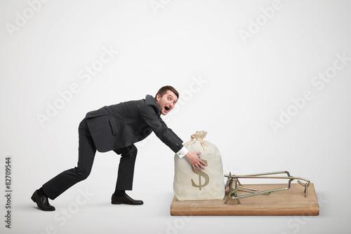 Cuadros en Lienzo man reaching his hands to take bag