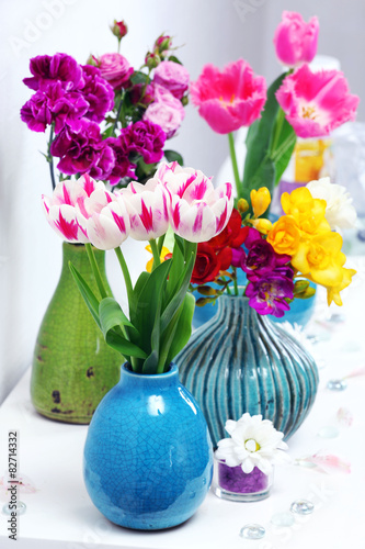 Different Beautiful Flowers In Vases On Table Close Up Buy This