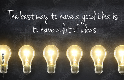 Light bulb lamps on blackboard background with idea quote Canvas Print