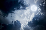 Fototapeta  - Dramatic Nighttime Clouds and Sky With Beautiful Full Blue Moon