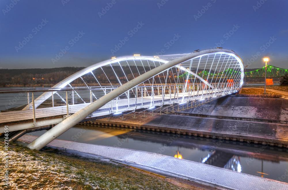 Illuminated footbridge over Zglowiaczka River in Wloclawek