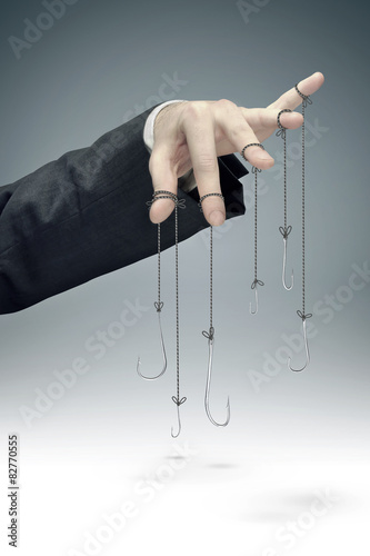Photo  conceptual image of the corporate manipulation
