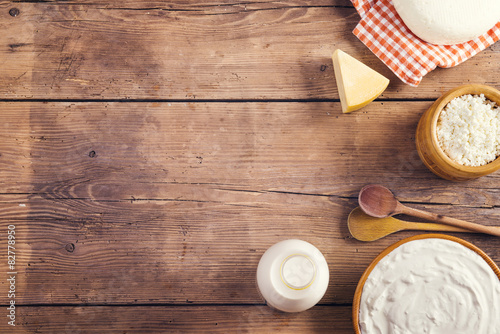 Foto op Aluminium Zuivelproducten Variety of dairy products laid on a wooden table background