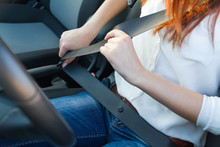 Woman Fastens A Seat Belt. Saf...