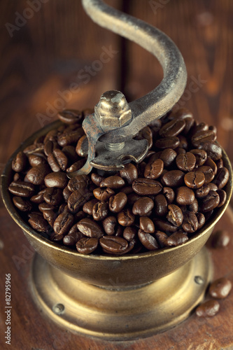 Fotografie, Obraz  Coffee grains in old coffee grinder