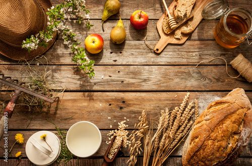 Photo Natural local food products on vintage wooden table - rustic composition captured from above