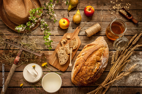 Natural local food products on vintage wooden table - rustic composition captured from above Wallpaper Mural