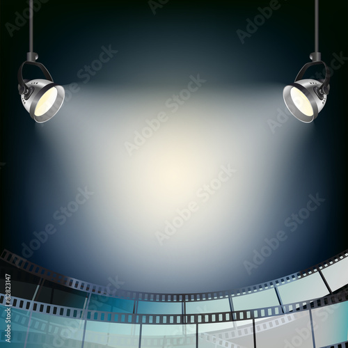 Photo  blue background with spot lights and filmstrip