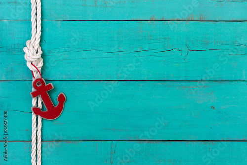 Fotografia  Blank nautical sign with rope and red anchor border