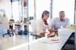 Leinwanddruck Bild - Office colleagues talking at work