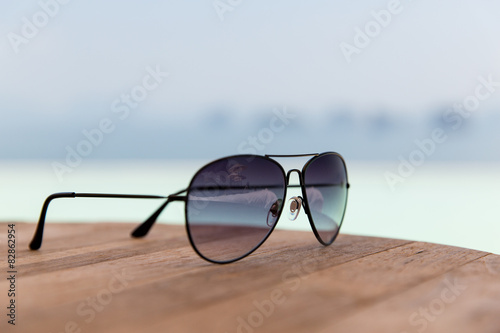 shades or sunglasses on table at beach