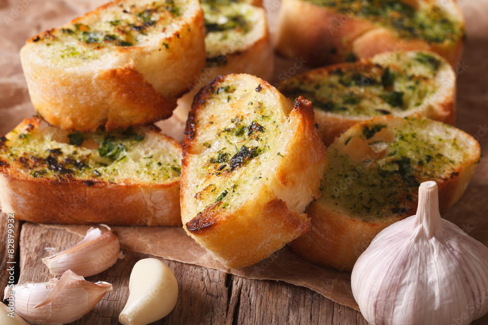 Toast with fresh herbs and garlic closeup. horizontal