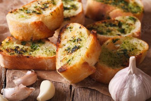 Valokuva  Toast with fresh herbs and garlic closeup. horizontal