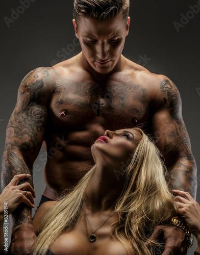 Fotografie, Obraz  Man and woman posing in studio