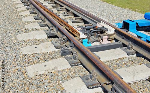Obraz na plátne Details of railway bifurcation on the gravel mound