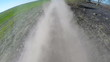Driving on rural dusty road.