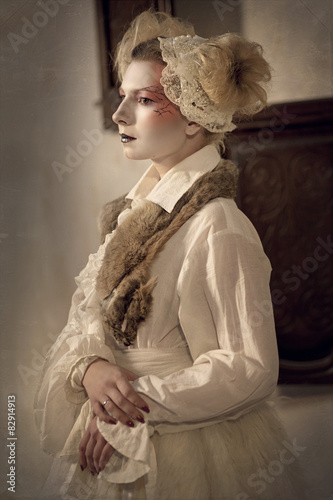 Fotografie, Obraz  Young  blonde girl  in the form of a porcelain doll