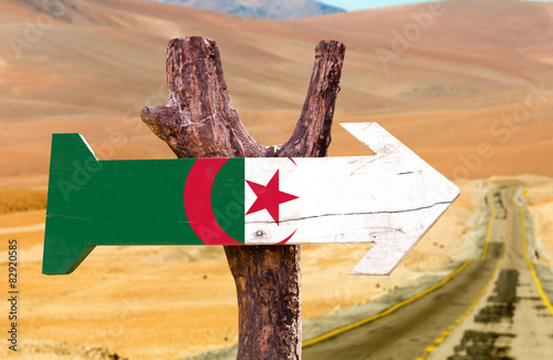 Algeria Flag wooden sign with desert road background