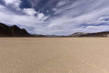 Dry Lake Bed In Desert With Cracked Mud On A Lake Floor