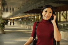 Asian Woman Talking On Cell Ph...