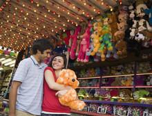 Multi-ethnic Teenaged Couple At Carnival