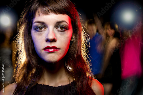 Fotografering  Disheveled drunk or female high on drugs at a nightclub
