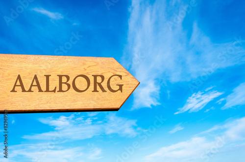 Photo  Wooden arrow sign pointing destination AALBORG, DENMARK