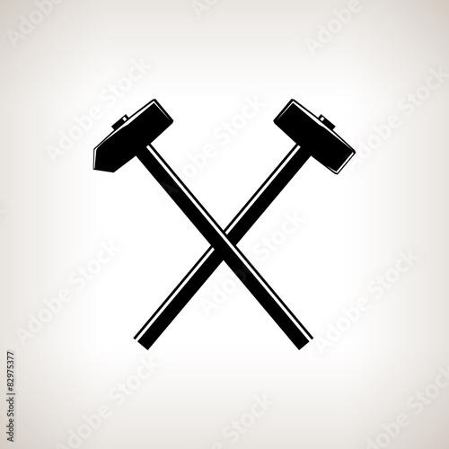 Silhouette of a crossed hammer and sledgehammer Fototapet