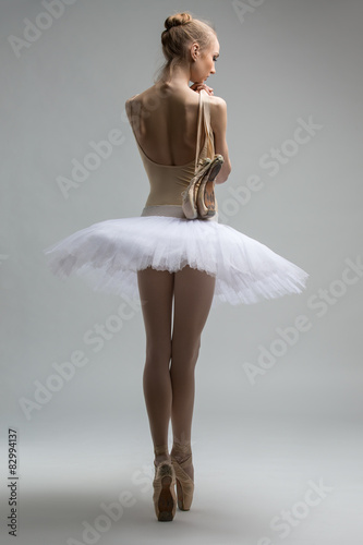 Portrait of young ballerina in white tutu Plakát
