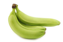 Fresh Still Unripe Bananas On A White Background
