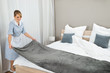 Female Housekeeping Worker Making Bed