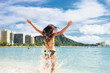 Beach fun - happy woman on Hawaii Waikikivacation
