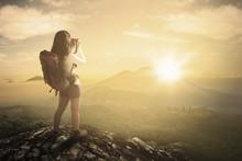 Female Backpacker Taking Photo...