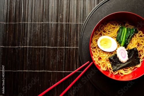 Photo  Ramen with red chopsticks