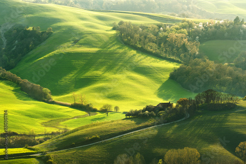 Recess Fitting Panorama Photos Pastoral green field with long shadows in Tuscany, Italy